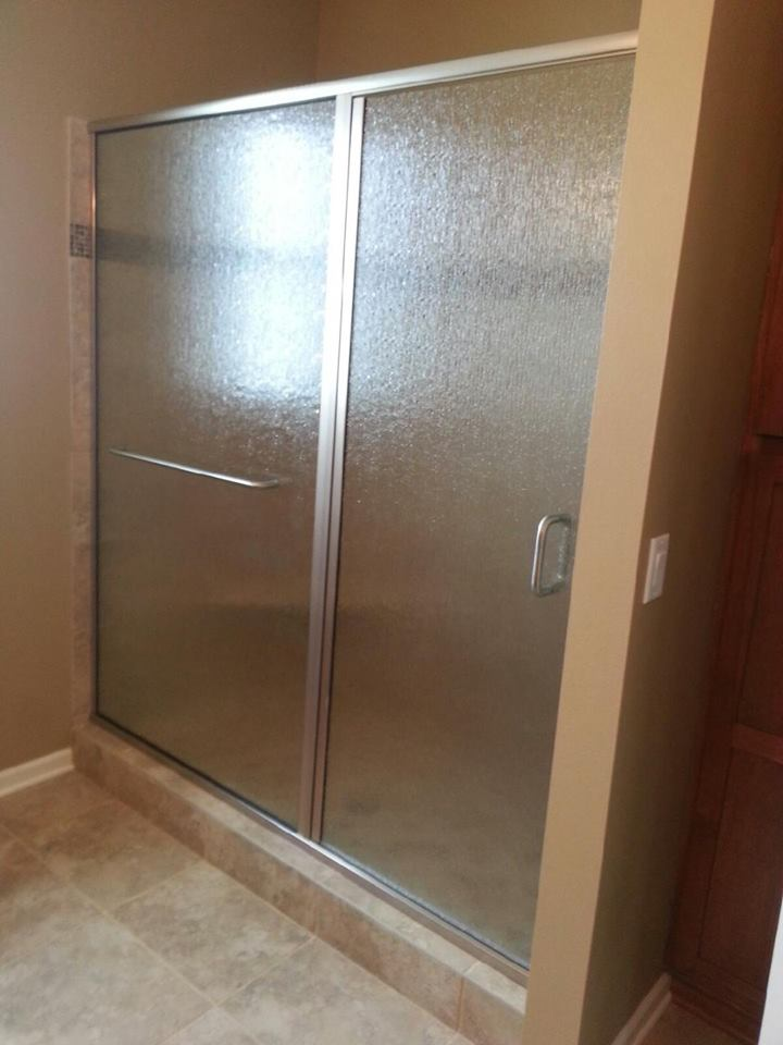 Rain glass with towel bar in panel with brushed nickel hardware