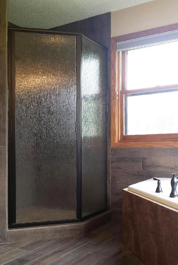 Rain glass with oil rubbed bronze corner shower in Polk City