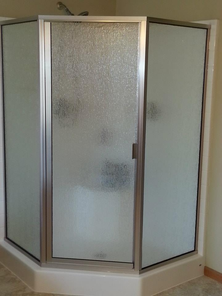 Neo angle semi-frameless with rain glass and brushed nickel hardware