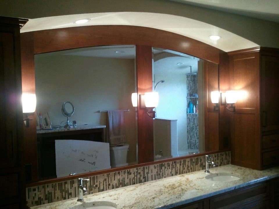 custom template arch top mirrors with bevel installed in wood frames