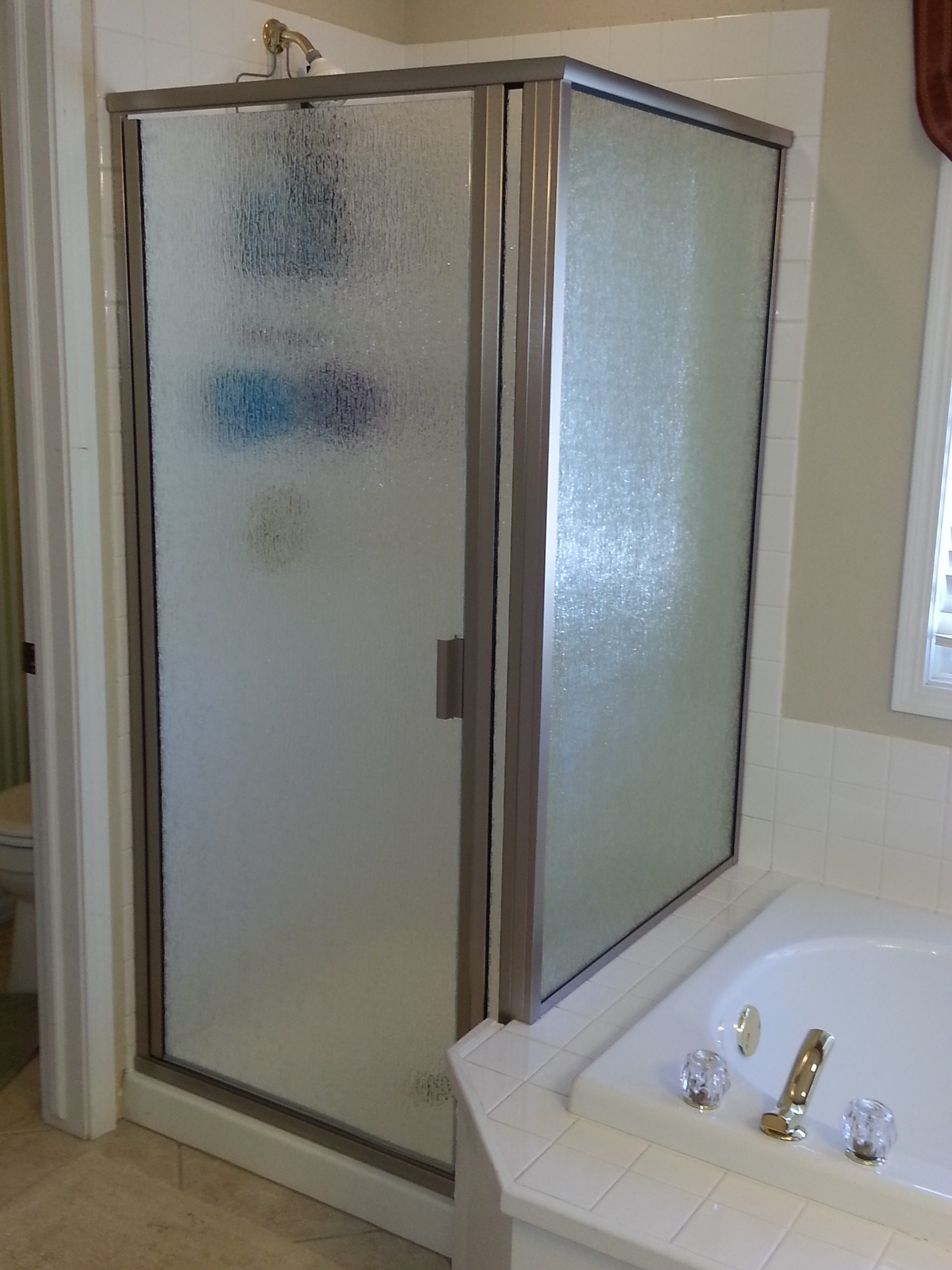 Semi-frameless door in clive with rain glass brushed nickel hardware compression handle