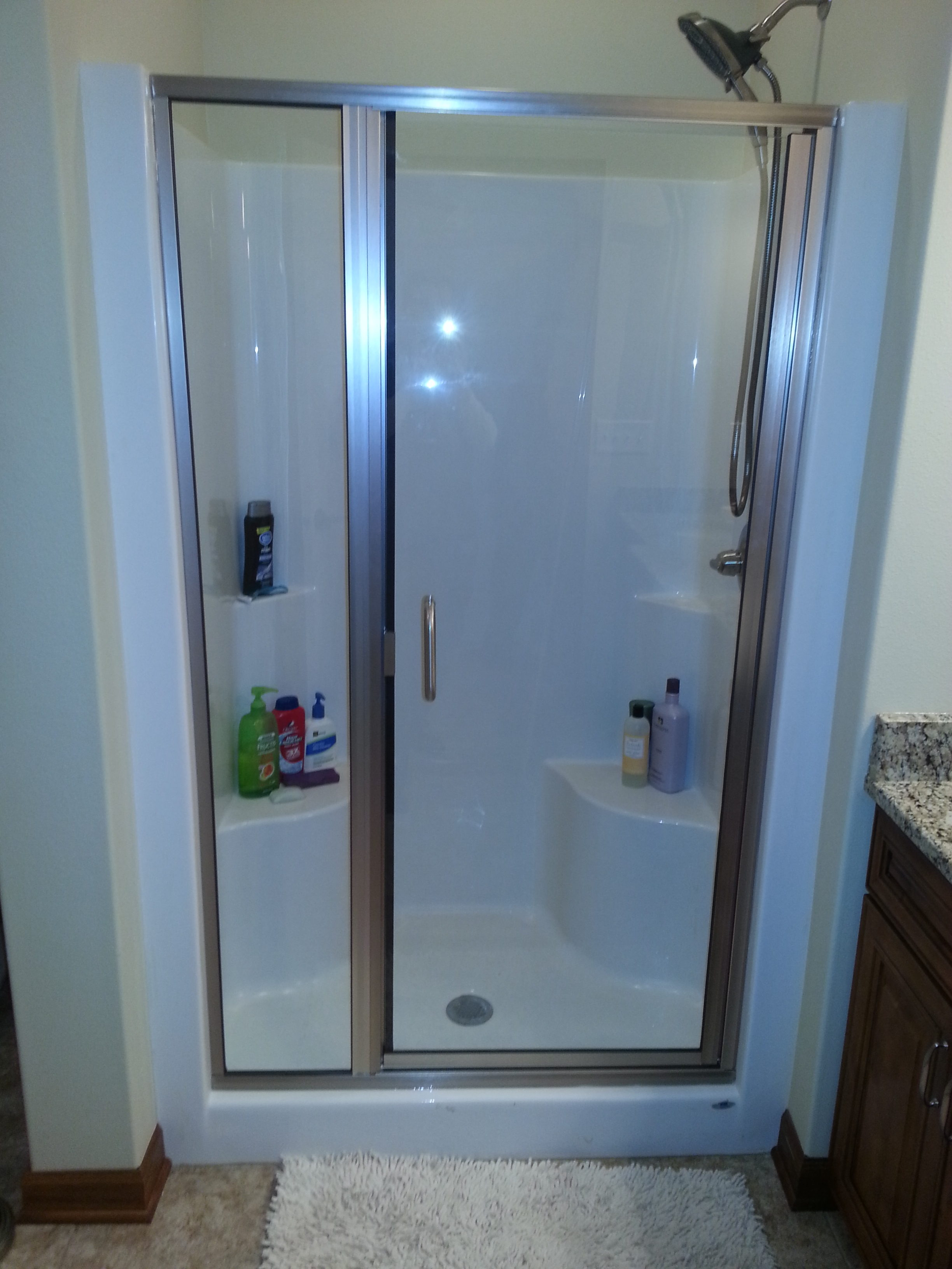 Semi-frameless shower door in urbandale with brushed nickel hardware clear glass