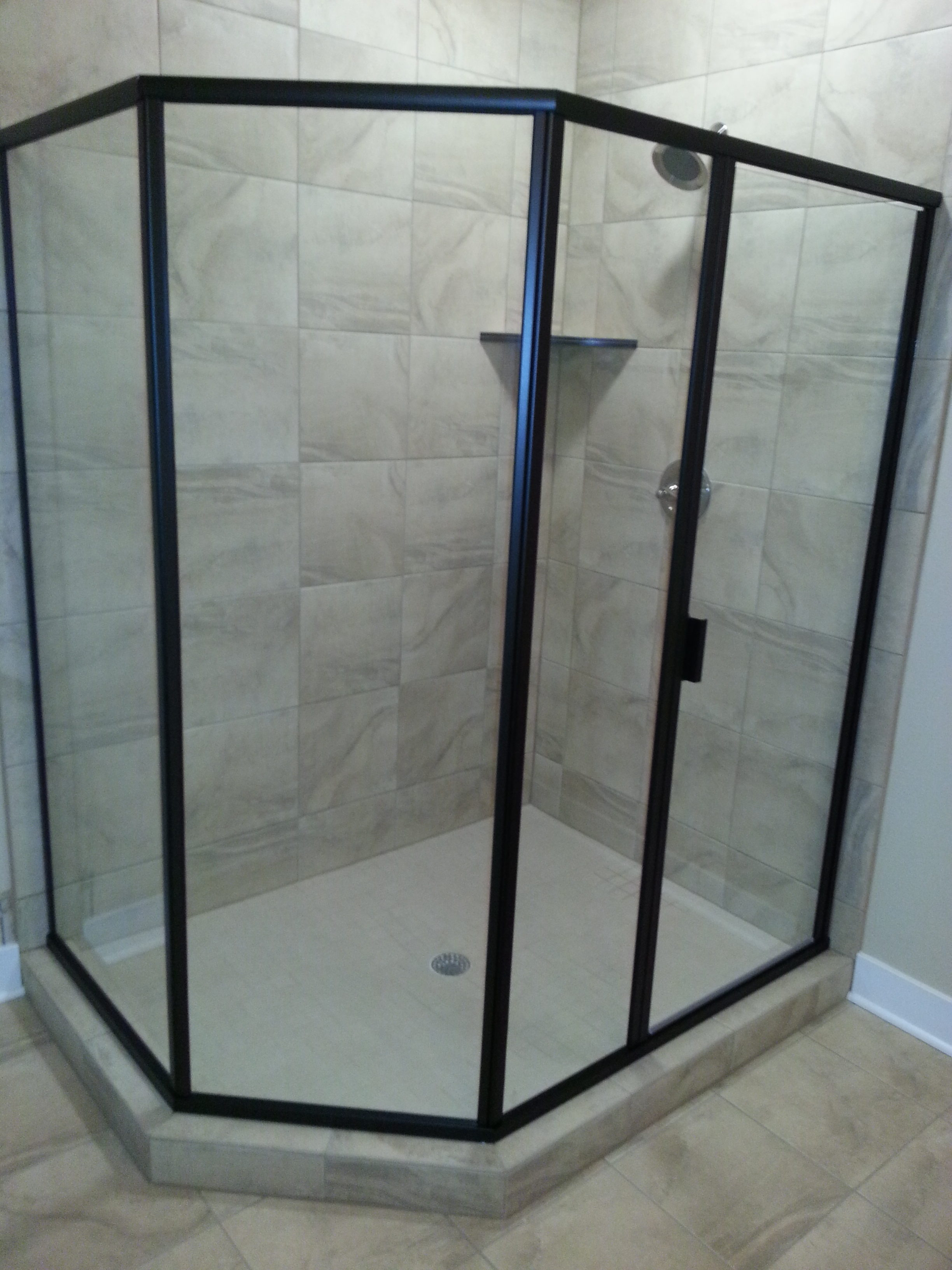 Neo angle shower door in Johnston with oil rubbed bronze hardware clear glass