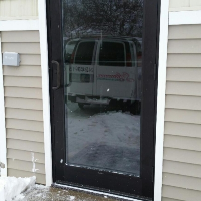 dark bronze commercial aluminum exterior door with Rim Panic