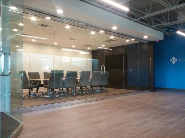 glass partition des moines, with large interior doors chrome hardware for conference room and offices