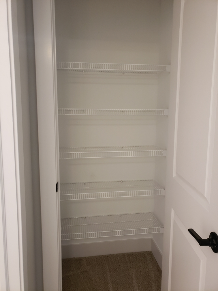 Wire shelving in a linen closet.