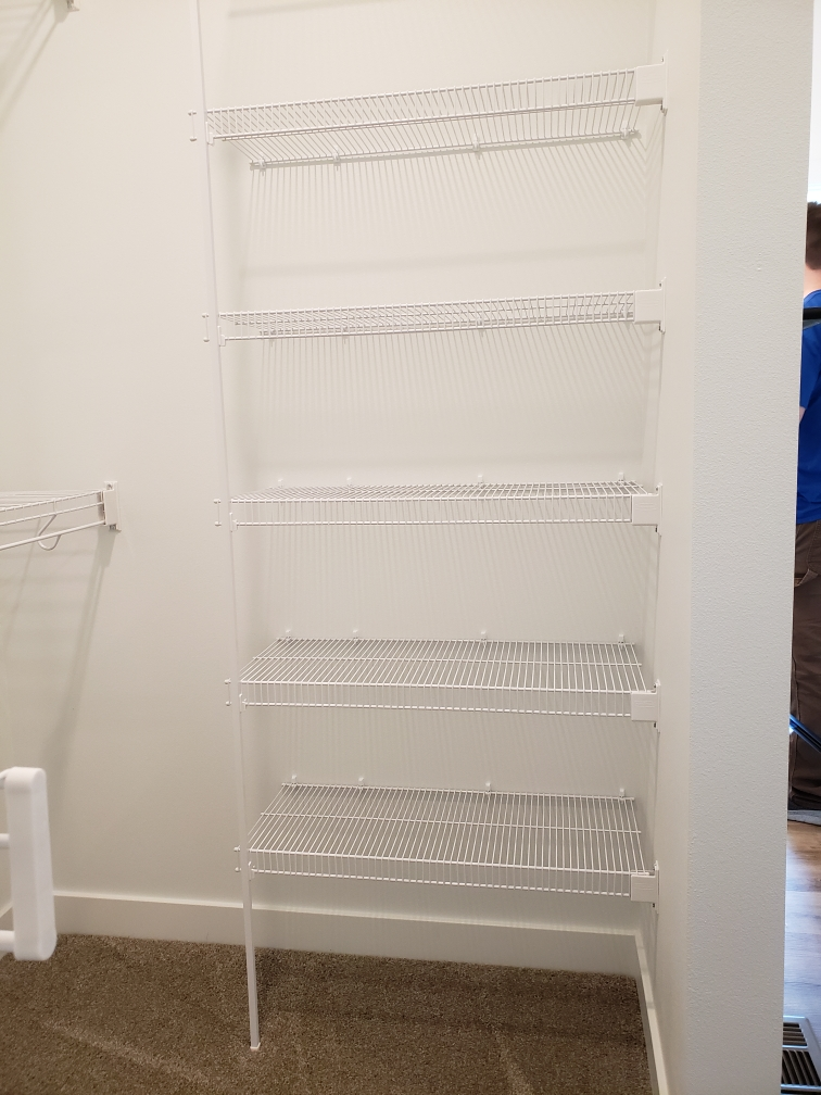 Wire shelving in a closet.
