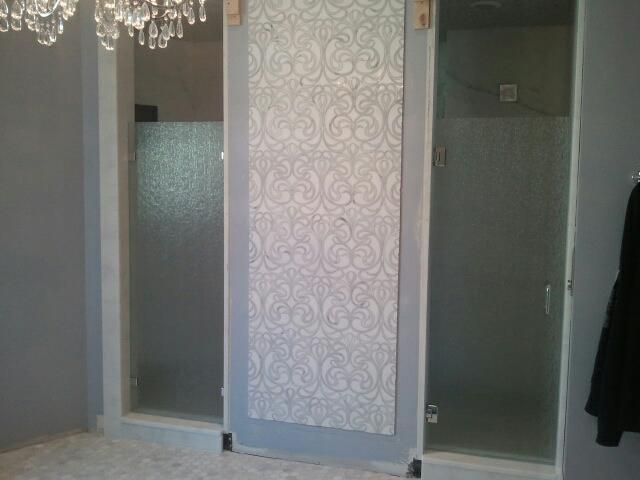 Single door and separate panel for a shower enclosure. Rain glass, and chrome hardware. The panel is installed with clamps.