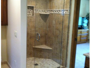 """3/8"""" Pivot door with inline panels on either side. Brushed nickel hardware clear glass"""