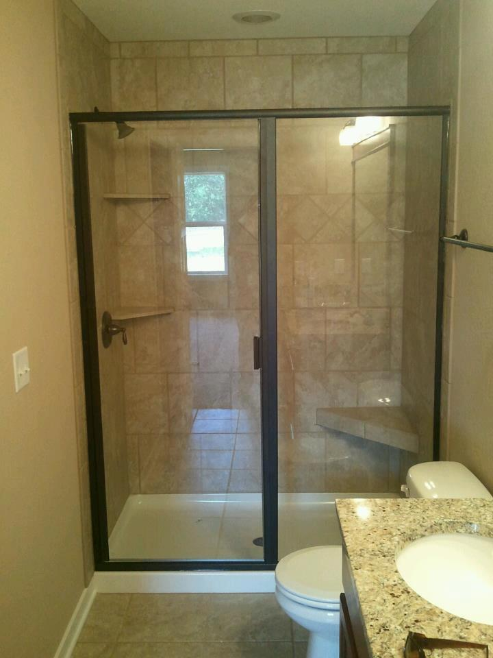 Oil rubbed bronze clear glass shower door with on fiberglass