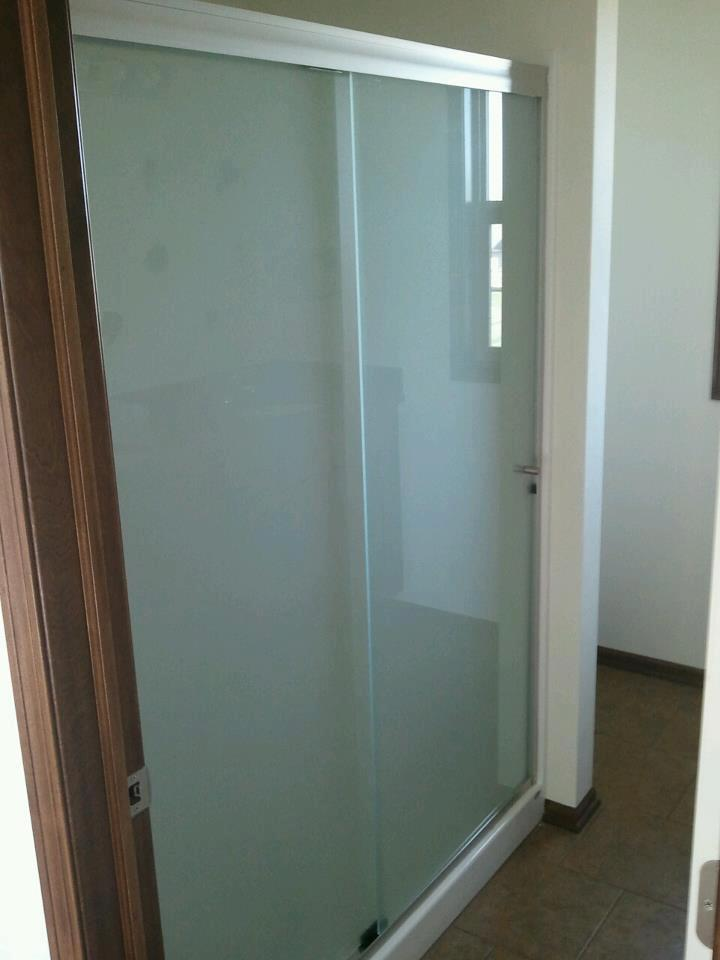 Satin etch glass slider with brushed nickel thru-glass pulls