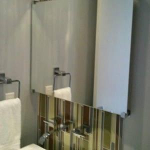 mirrors with edge grip stand offs for a frameless look