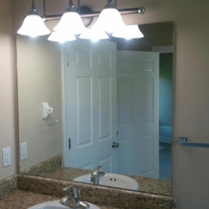 frameless mirror installed into a new construction spec home in waukee