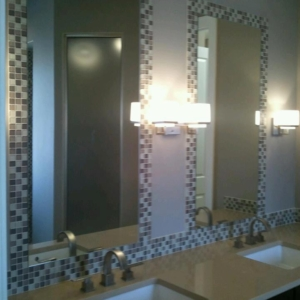 custom cut mirrors installed between mosaic glass tile