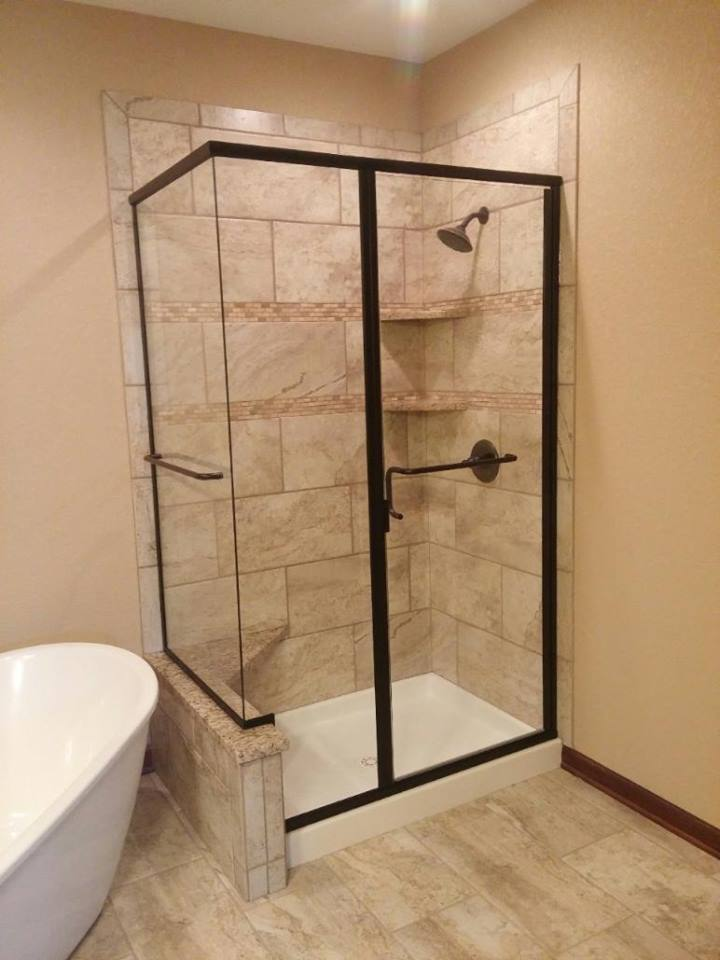 Oil rubbed bronze hardware with towel bar on return panel and c-pull towel bar combo