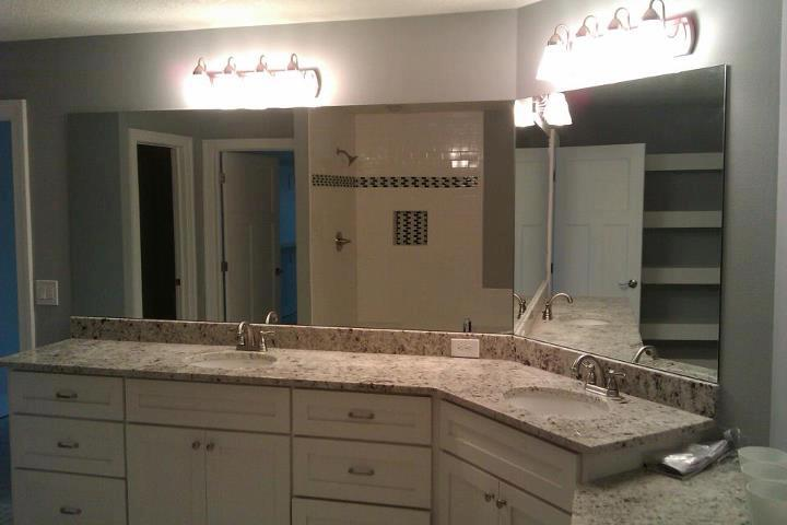 custom cut frameless mirrors on a two sided vanity installed in urbandale